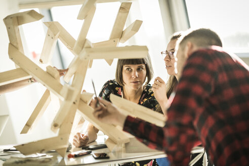 Group of creative professionals building wood object for a project - MJRF00196