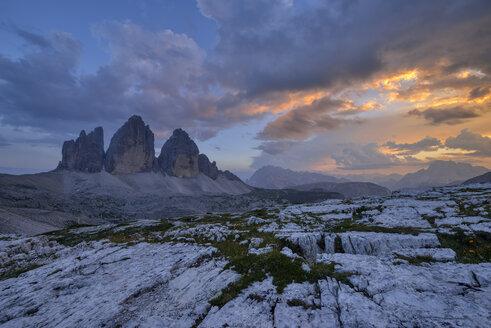 Italy, Sexten Dolomites, Tre Cime di Lavaredo at sunset, Nature Park Tre Cime, Unesco World Heritage Natural Site - RUEF02135