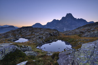 Italy, Dolomites, Pale di San Martino Mountain group with mountain peak Cimon della Pala and two small mountain lakes at sunrise - RUEF02159