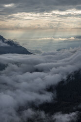 Italy, Dolomites, Sout Tyrol, View from the mountain Seceda to clouds over mountains - RUEF02171