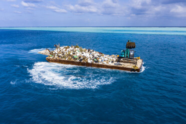 Maledives, South-Male-Atoll, plastic waste disposal with digger - AMF06894