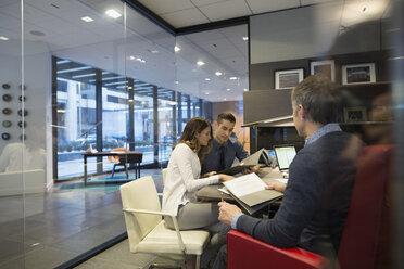 Business people meeting in bossí_ŒÇs office - HEROF35896