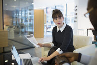 Business people using laptop at office lobby - HEROF35926