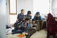 Boys hanging out using digital tablets laptop bedroom - HEROF35938