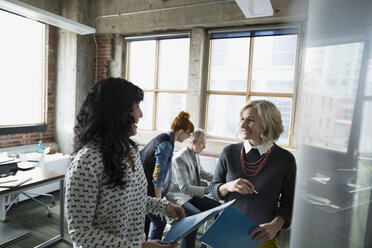 Businesswomen brainstorming in office - HEROF35953