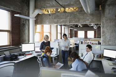 Business people meeting in open plan office - HEROF35956