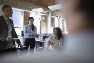 Business people talking in meeting in office - HEROF35962