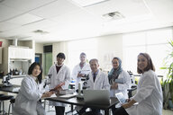 Portrait smiling professor and college students in science laboratory - HEROF36154