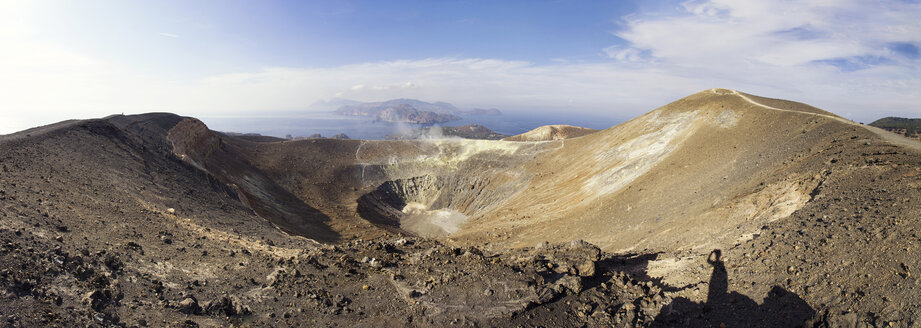Aeolian Islands, Vulcano, Panoramic view from volcano, Gran Cratere, shadow of hiker at volcanic crater - MAMF00515
