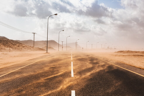 Sultanate Of Oman, Ras al Hadd, Desert road in a sand storm - WVF01126