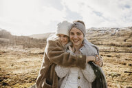 UK, Scotland, happy female friends hugging in rural landscape - LHPF00552
