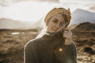 UK, Scotland, Loch Lomond and the Trossachs National Park, portrait of young woman in rural landscape - LHPF00576