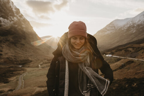 UK, Scotland, Highlands, smiling young woman in rural landscape - LHPF00579