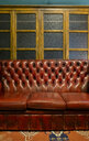Leather sofa in a vintage furniture shop - MGOF04022