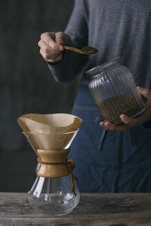Close-up of man preparing filtered coffee - ALBF00839