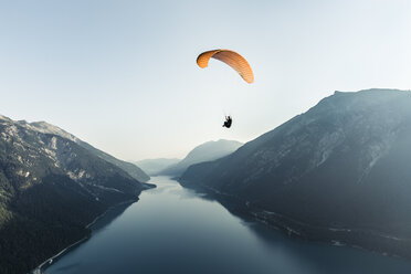 Austria, Tyrol, Paraglider over lake Achensee in the early morning - WFF00085