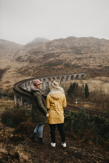 UK, Scotland, Highland, Glenfinnan Viaduct, female friends looking at view - LHPF00588