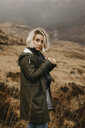 UK, Scotland, Highland, portrait of young woman in rural landscape - LHPF00591
