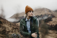 UK, Scotland, Highland, pensive young woman in rural landscape - LHPF00597