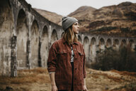 UK, Scotland, Highland, portrait of young woman at Glenfinnan Viaduct - LHPF00603