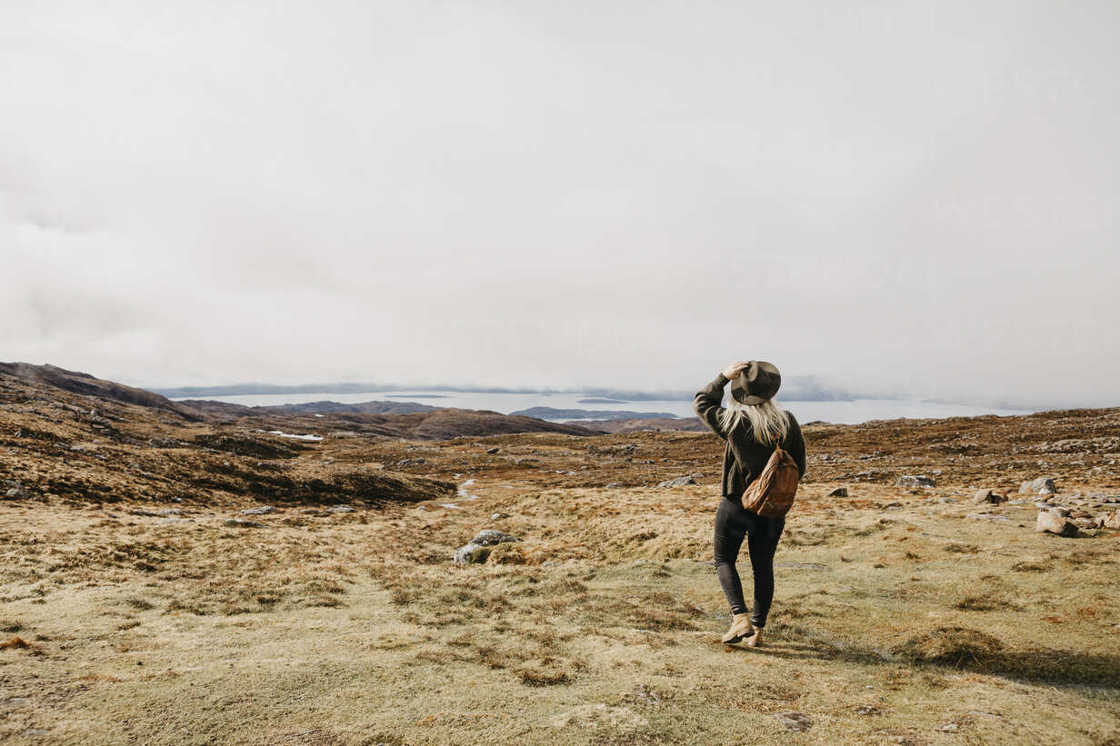 UK, Scotland, Highland, Applecross, rear view of young woman in rural landscape - LHPF00642 - letizia haessig photography/Westend61