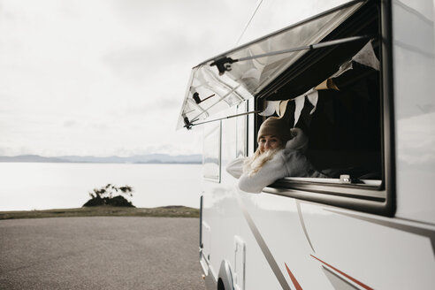 UK, Scotland, Highland, young woman at the window of a camper van - LHPF00651