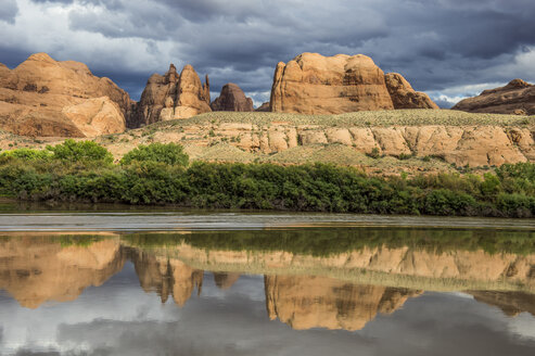 USA, Utah, Sandstone rocks reflecting in the Colorado river, Canyonlands National Park - RUNF01853