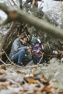 Mother with little daughter in a shelter in forest - DWF00427