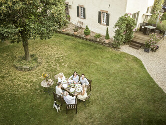 Family eating together in the garden in summer - PESF01560