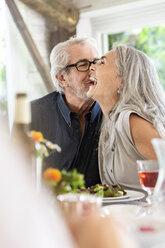 Senior couple celebrating with their family - PESF01599