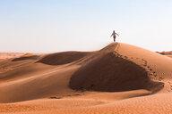 Man walking on a sand dune, Wahiba Sands, Oman - WVF01348