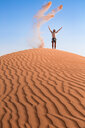 Sultanate Of Oman, Wahiba Sands, Mid adult man is playing with sand in the desert - WVF01351