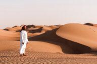 Bedouin in National dress standing in the desert, Wahiba Sands, Oman - WVF01378