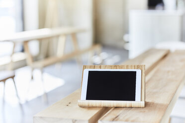 Tablet on wooden bench - FMKF05586