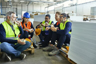 Workers in factory having lunch break together - ZEDF02130