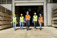 Group of workers walking on factory yard - ZEDF02208