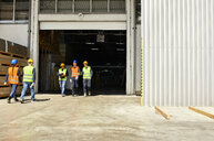 Group of workers walking on factory yard - ZEDF02214