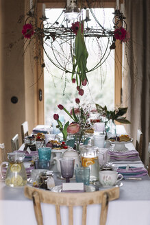 Laid table with floral decoration at springtime - ALBF00861