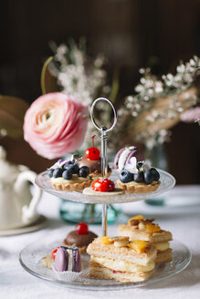 Various pastries on glass cake stand - ALBF00864