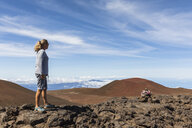 USA, Hawaii, Mauna Kea volcano, female tourist looking at view over volcanic landscape - FOF10671