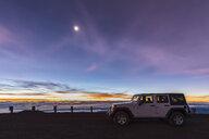 USA, Hawaii, Mauna Kea volcano, off road vehicle at dawn with full moon - FOF10677