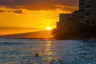 Hawaii, Oahu, Waikiki beach, sunset over the high rise buildings - RUNF01899