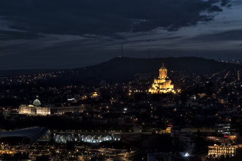 Georgia, Tbilisi, cityscape with Holy Trinity Cathedral at night - ALRF01443