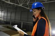 Serbia, Stara Pazova, Warehouse, Worker, Smartphone - ZEDF02241