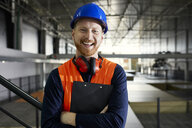 Portrait of happy worker in factory warehouse - ZEDF02244