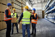 Workers talking in factory warehouse - ZEDF02271