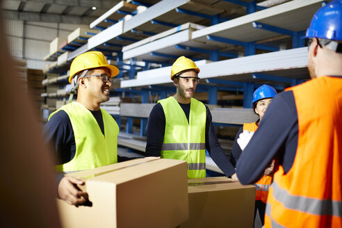 Workers talking in factory warehouse - ZEDF02274