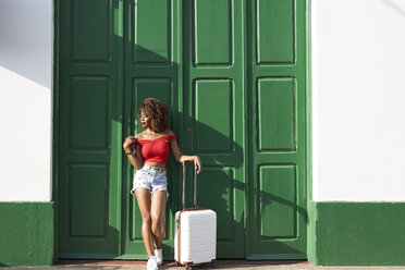 Woman in red with a suitcase and a phone - VEGF00042