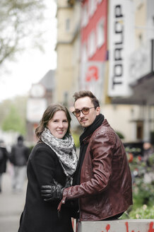 Portrait of stylish young couple in the city - EYAF00165