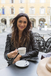 Young woman with cup of coffee - MGIF00399